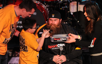 """Rebecca Droke/Post-Gazette- Thursday, February 7, 2013- STANDALONE- Aaron Smith looks on as his son Elijah Smith, 9 years  clips Steeler Brett Keisel's beard during the third annual """"Shear Da Beard"""" benefit for Children's Hospital of Pittsburgh of UPMC at Jergel's Rhythm Grille in Warrendale on Thursday, February 7, 2013. The ''ultimate mountain man makeover benefits the Division of Hematology/Oncology at Children's Hospital. Elijah received treatment at the hospital for leukemia.  Krystle Sierras, Coroapolis, Sport Clips in McCandless is at right..LOCAL  PUBLISHED CAPTION: Rebecca Droke/Post-GazetteWith support from his dad, former Steelers player Aaron Smith, and Krystle Sierras of Sport Clips in McCandless, 9-year-old Elijah Smith clips the beard of defensive end Brett Keisel during the third annual Shear Da Beard benefit Thursday at Jergels Rhythm Grille in Warrendale. The ultimate mountain man makeover benefits the hematology/oncology division of Childrens Hospital of Pittsburgh of UPMC. Elijah received treatment at the hospital for leukemia.            Rebecca Droke/Post-GazetteWith support from his dad, former Steelers player Aaron Smith, and Krystle Sierras of Sport Clips in McCandless, 9-year-old Elijah Smith clips the beard of defensive end Brett Keisel during the third annual Shear Da Beard benefit Thursday at Jergels Rhythm Grille in Marshall. The ultimate mountain man makeover benefits Childrens Hospital of Pittsburgh of UPMC, where Elijah received treatment for leukemia. For video, visit post-gazette.com.   Original Filename: 01ShearDaBeard0208.jpg"""